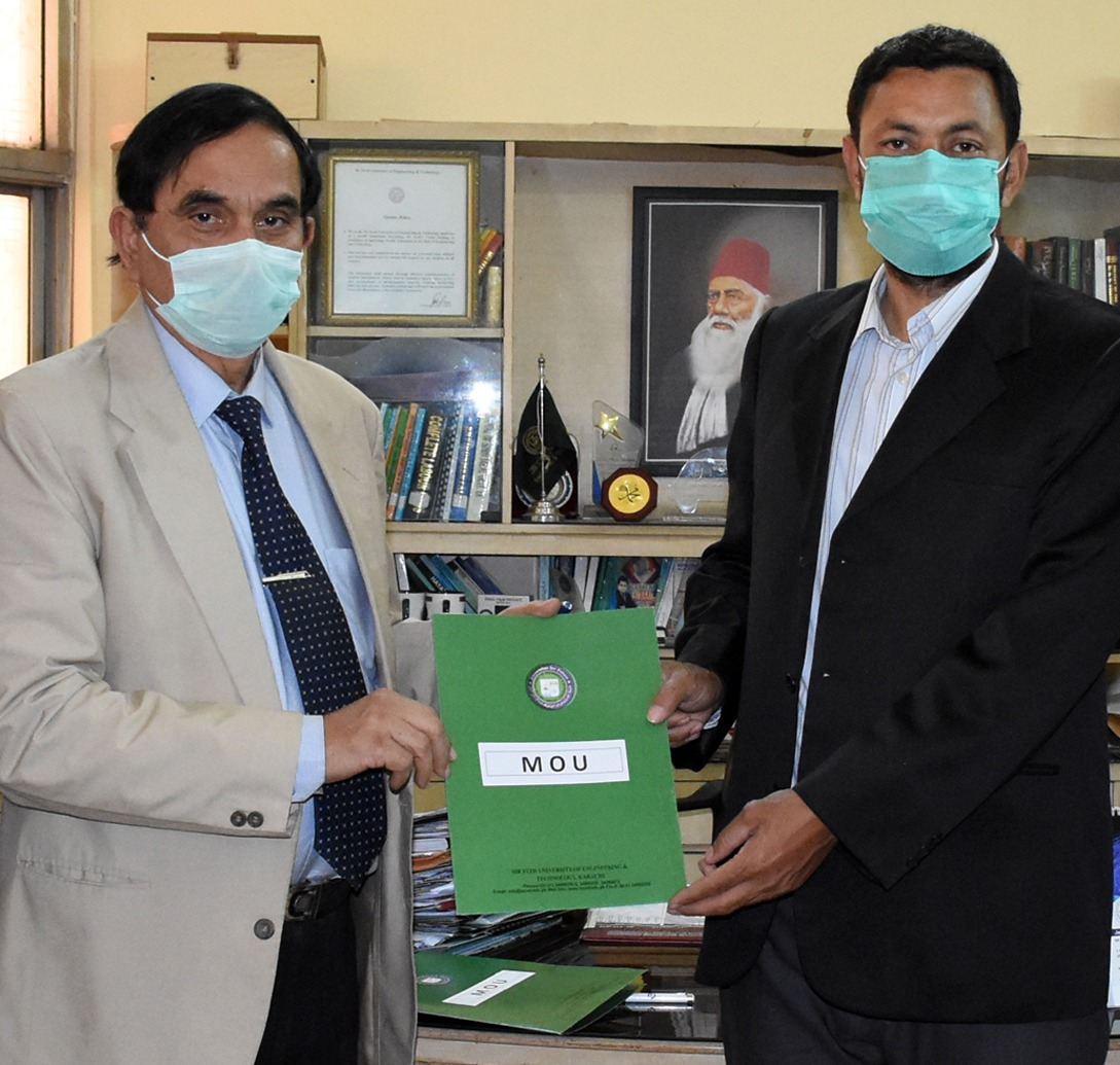 Registrar Syed Sarfraz Ali and Arshad Yousafzai after signing the MoU